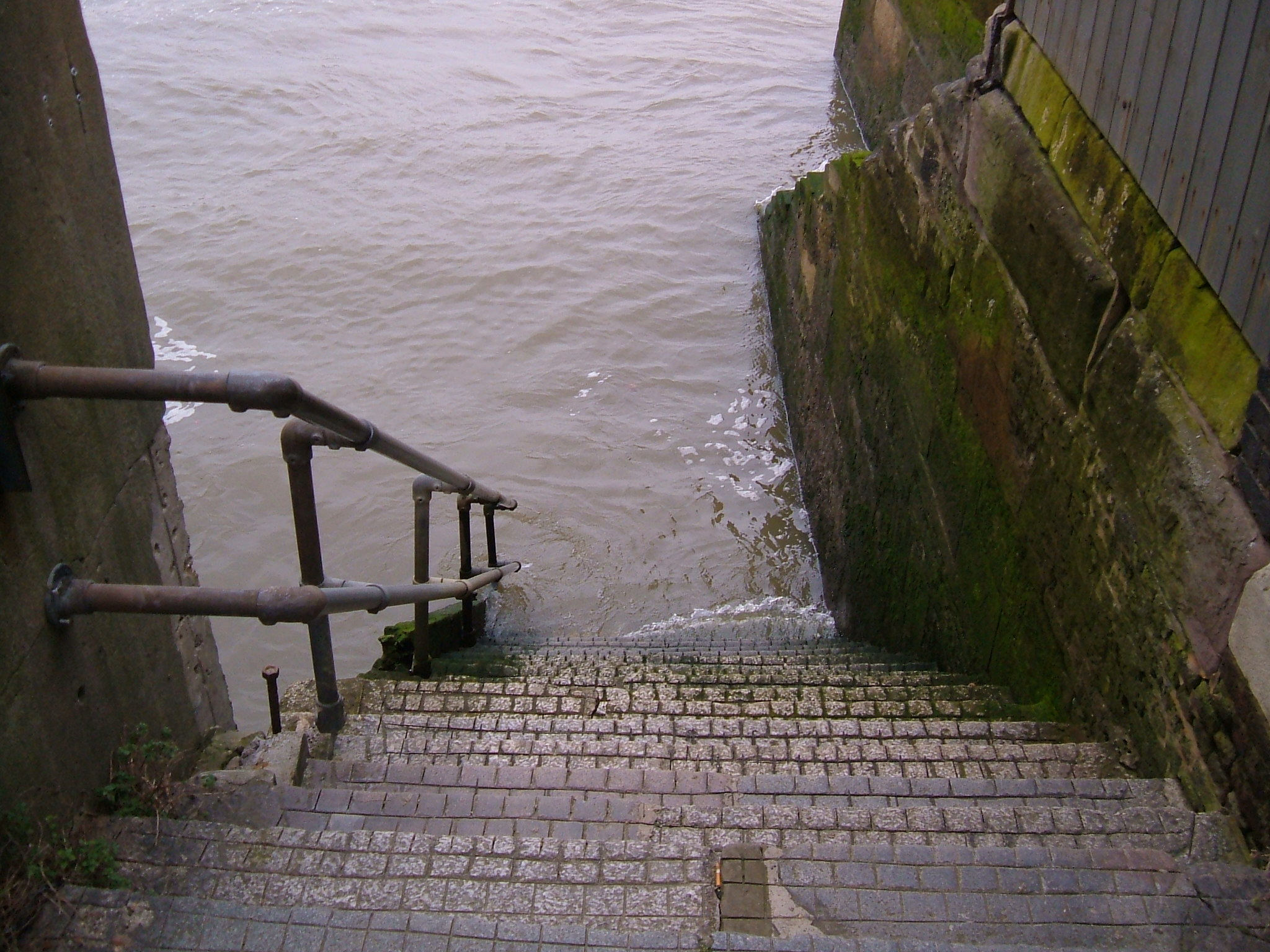 Steps down to the river at end of alley execution dock
