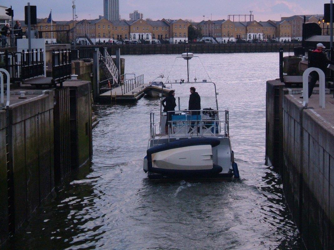 Boat leaving the Limehouse Lock, swing bridge opened