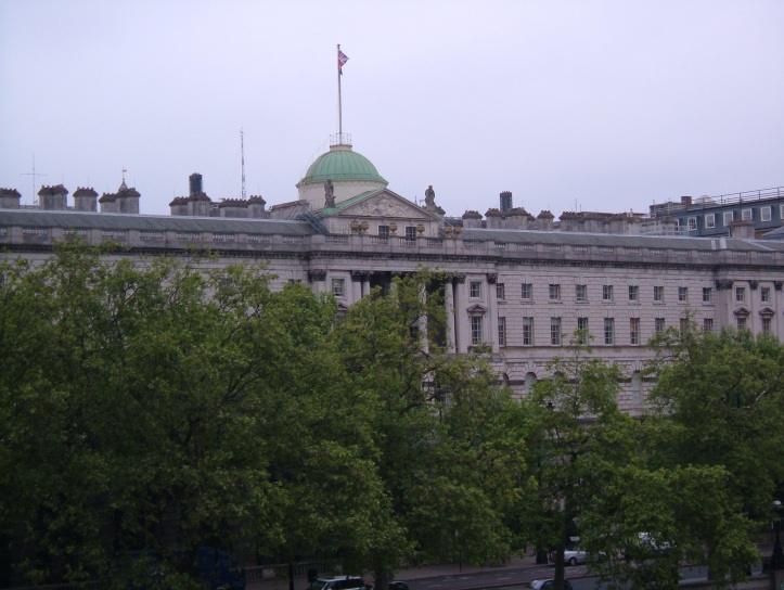 Somerset House from Waterloo Bridge today, obscured by trees and separated from the river by the Embankment