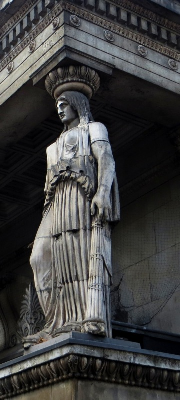 One of the caryatides from a matching porch on the south side