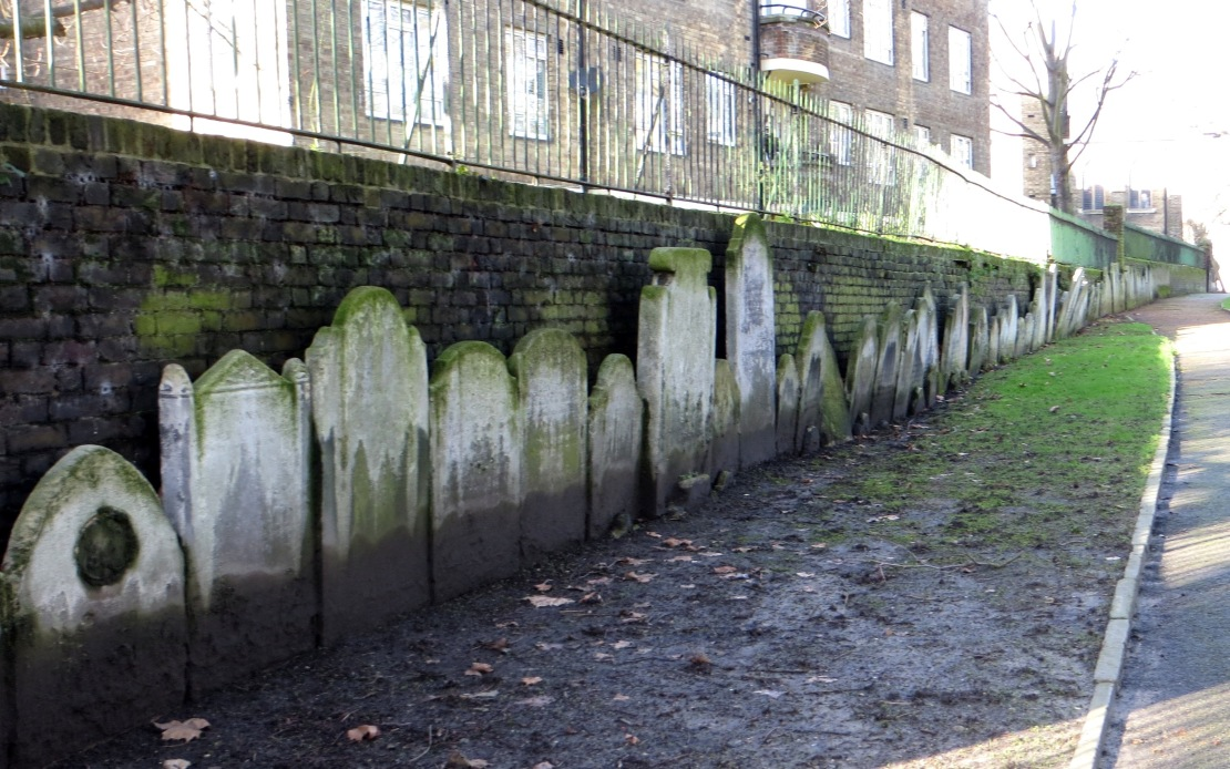 Gravestones lined up in the graveyard of St Mary on Paddington Green