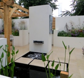 Water feature built into tower with oven
