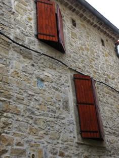 Shutters & stonework in Claret