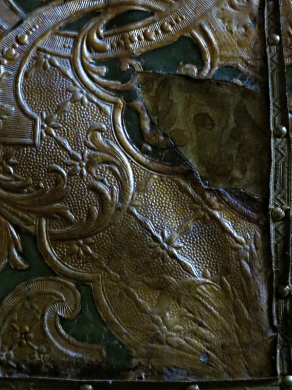 Tooled leatherwork on door