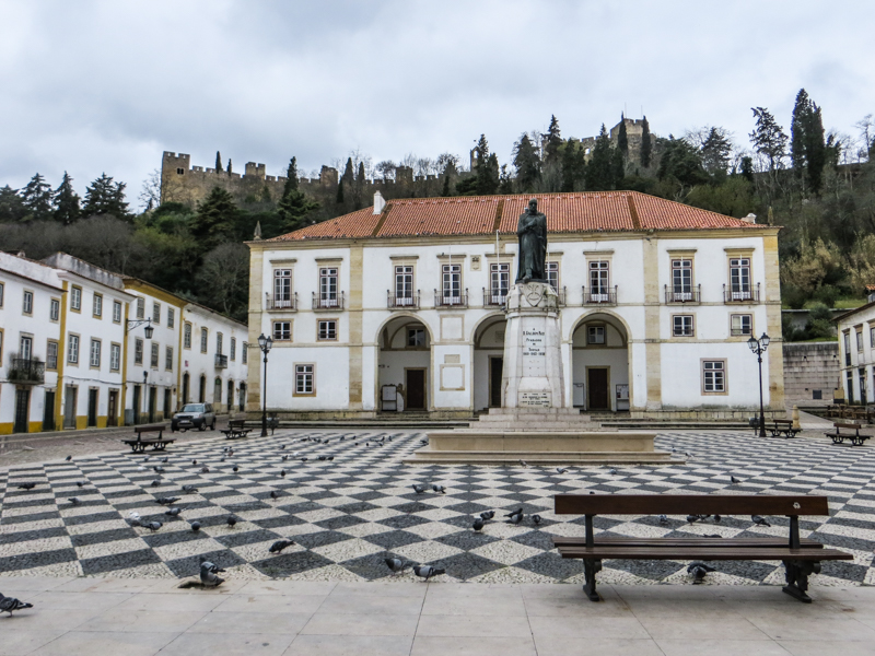 Tomar Town Square with a statue of Gualdim Pais, and the Castle in the background
