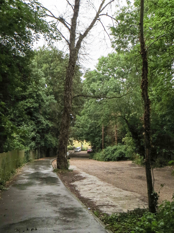 Ravensbourne Avenue, a  dirt road climbing out of Beckenham Place Park - entry gate at the bottom of the hill