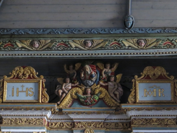 Carving heading the retable in the south aisle
