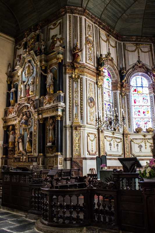 St Thegonnec - the 17C Rosary Altar piece on the left of the High Altar