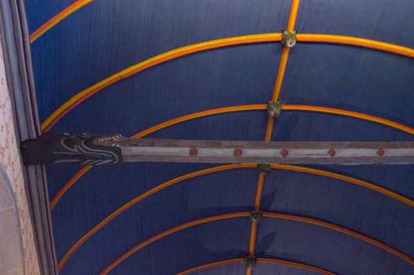 Carved beam inside Sizun Church