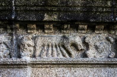 Animal suckling young, Sizun Church