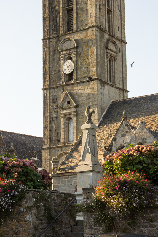 The Tower of Sizun Church, with the War Memorial in the foreground