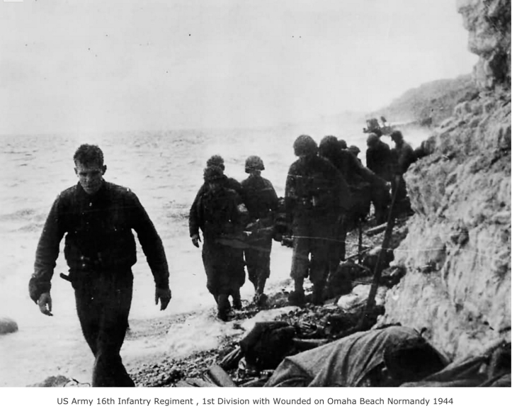 Soldiers with wounded on Omaha Beach (http://www.worldwarphotos.info/gallery/france/normandy-1944/us-16th-inf-reg-1st-division-with-wounded-on-omaha-beach-normandy-1944/)