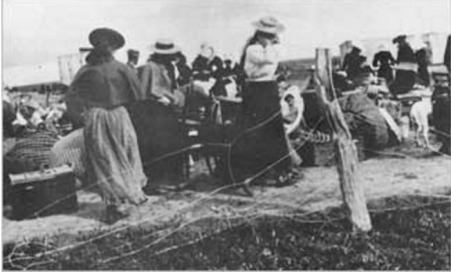 Boer women entering a concentration camp (http://reformation.org/boer-war.html)