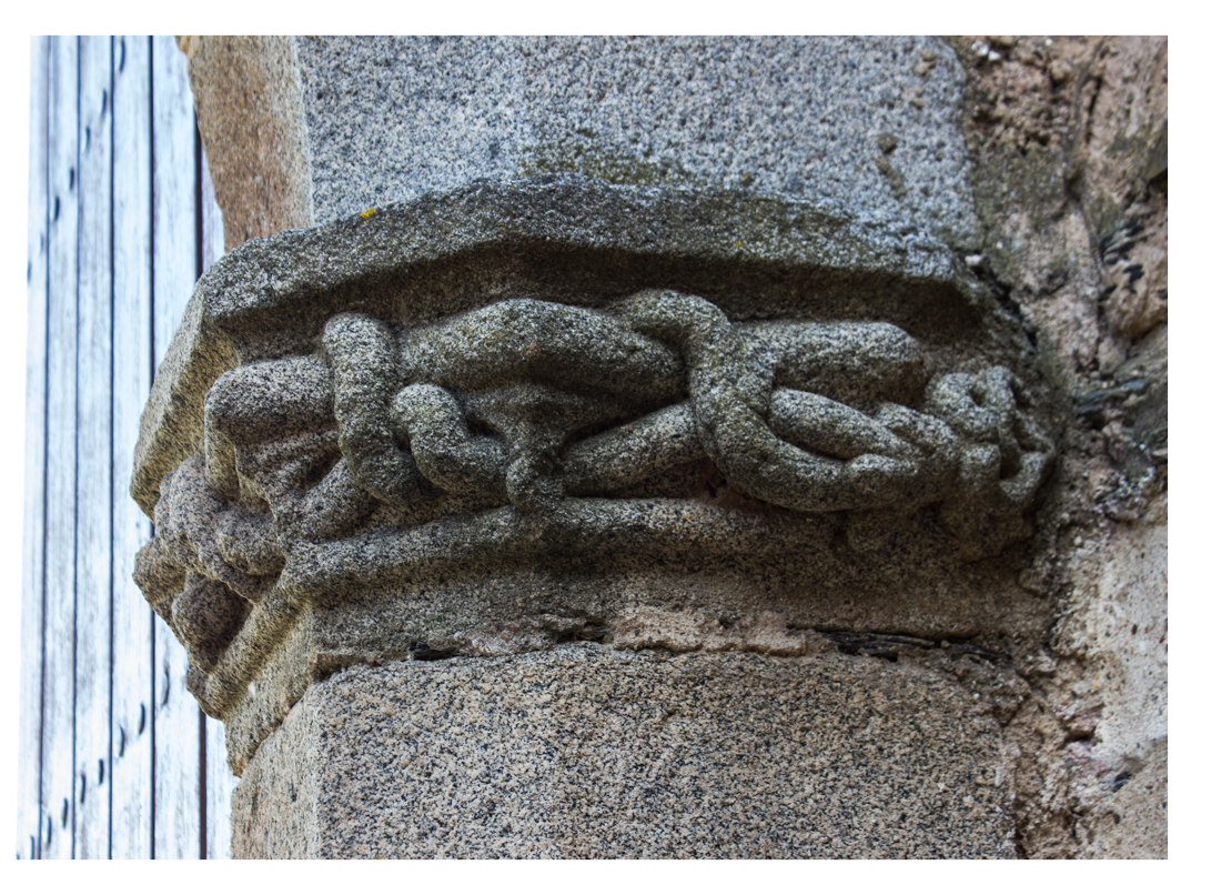 Carvings on the inner door of the Village Gate, Terena Castle