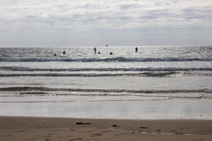 Surfers in the Anse de Pen Hat