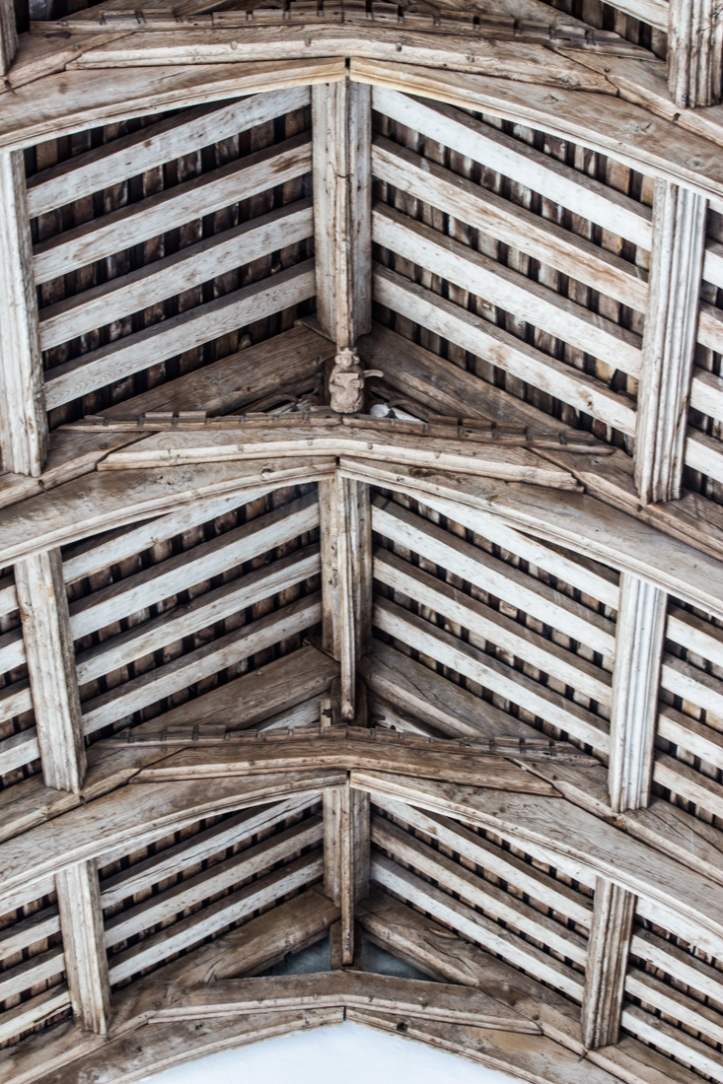The hammerbeam roof in Fressingfield Church, with an angel on the tie bar