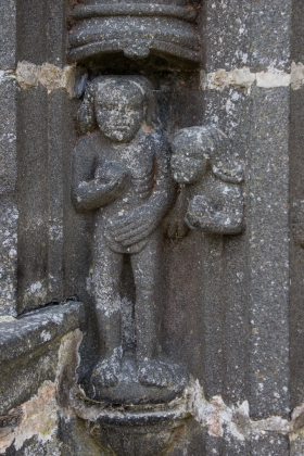 Adam being tempted in the Garden of Eden, Church of Guimiliau