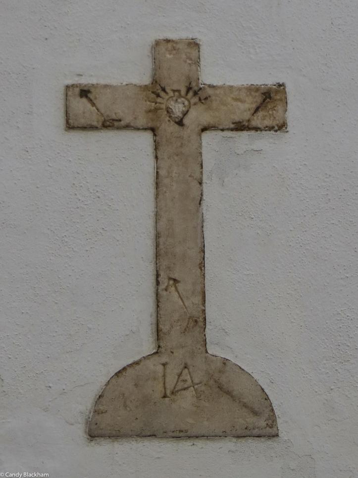 Cross on the wall of Nossa Senhora de Soledade