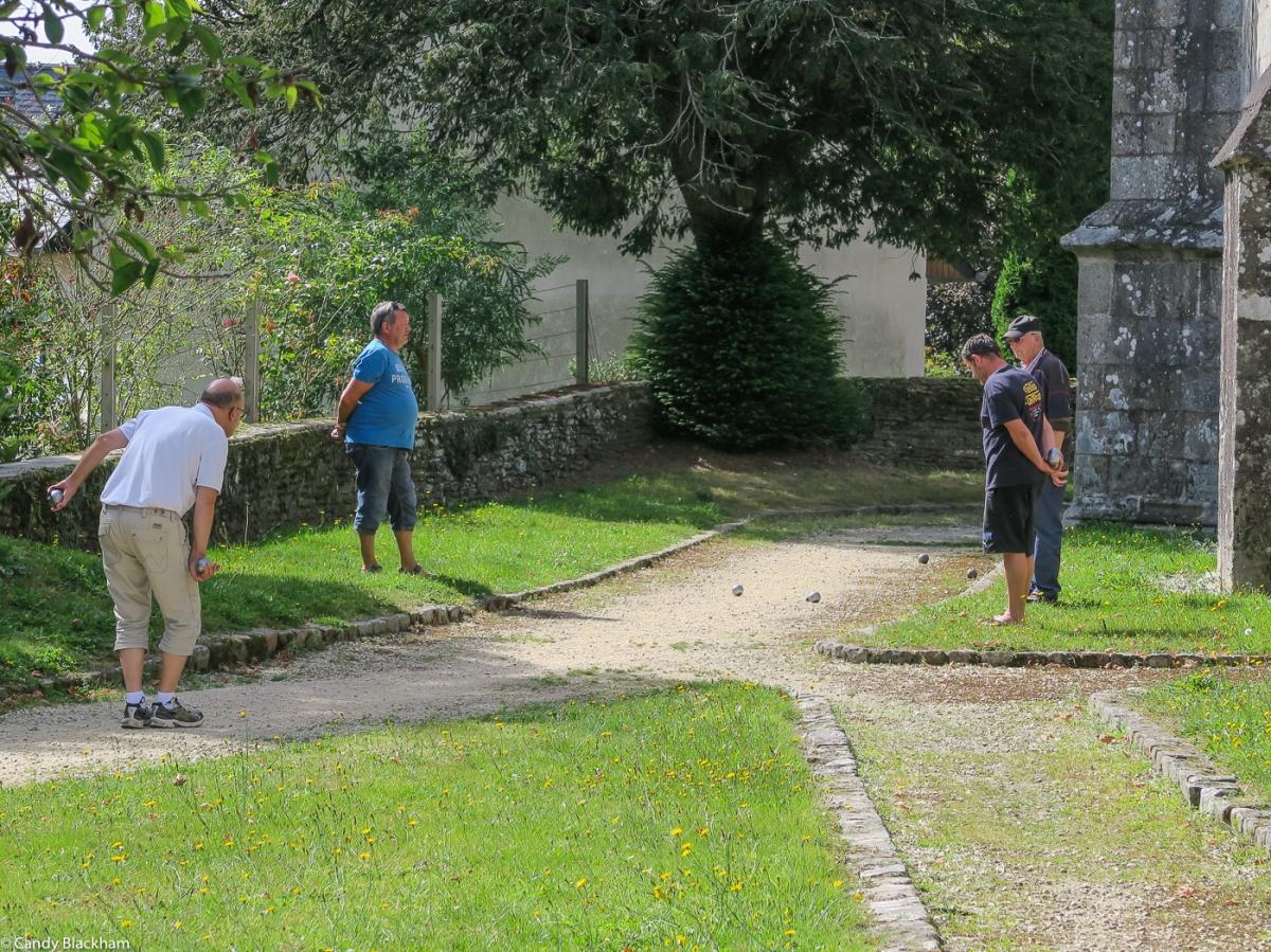 Boules outside Notre Dame of Cleden-Poher