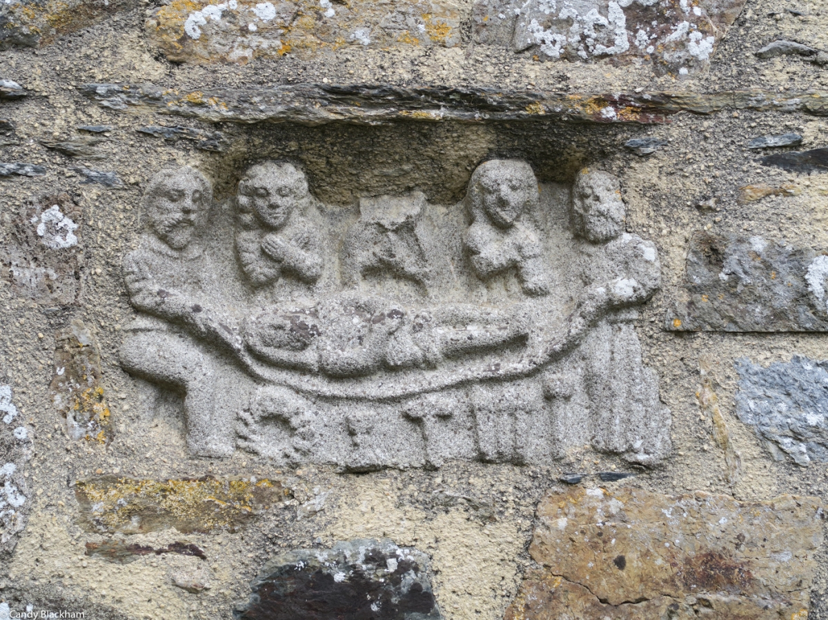 Entombment embedded in a wall