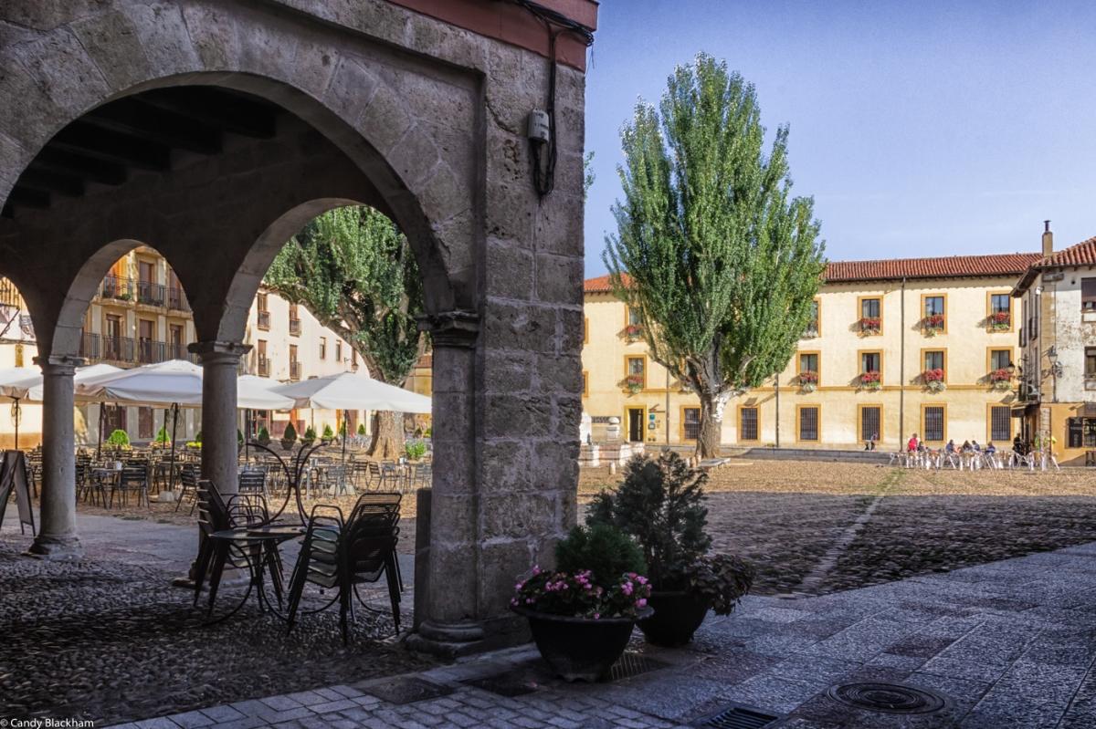 The Plaza del Grano with the Hospederia Monastica glowing in the evening sun